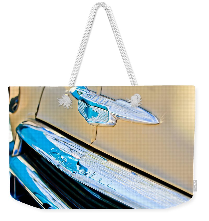 1951 Chevrolet Style Deluxe Emblem Weekender Tote Bag featuring the photograph 1951 Chevrolet Style Deluxe Grille Emblem by Jill Reger