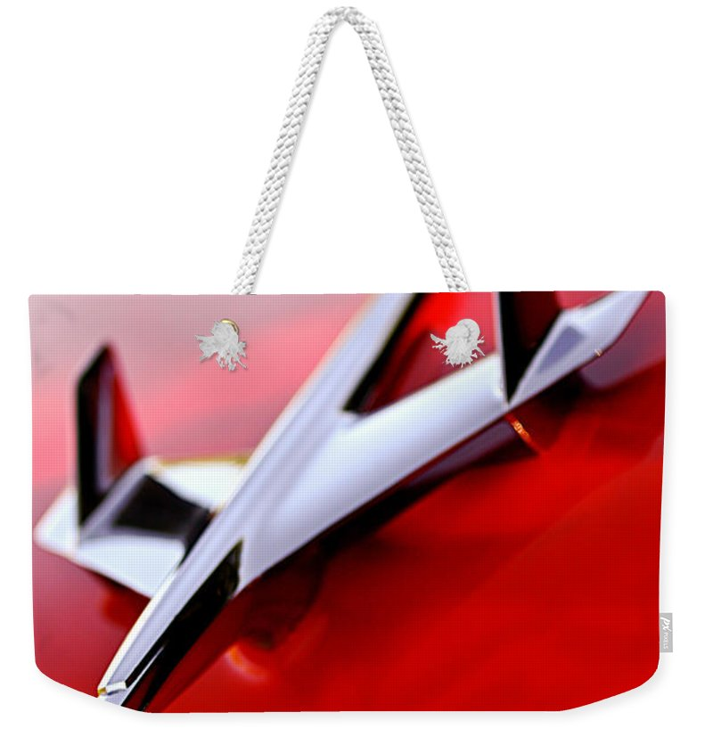 1955 Chevrolet Belair Nomad Hood Ornament Weekender Tote Bag featuring the photograph 1955 Chevrolet Belair Nomad Hood Ornament by Jill Reger