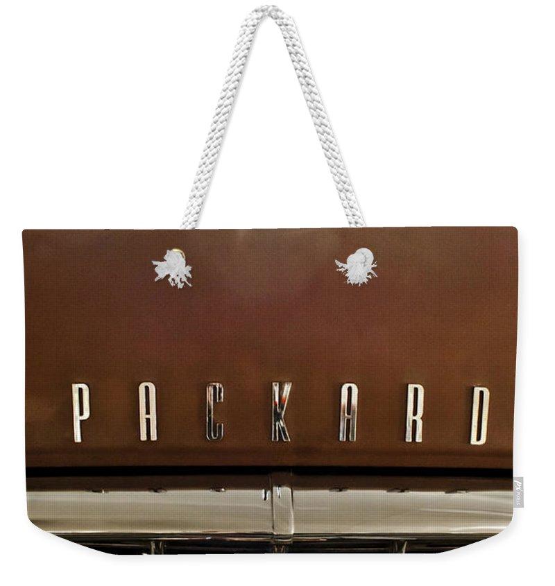 1955 Packard 400 Weekender Tote Bag featuring the photograph 1955 Packard 400 Hood Ornament by Jill Reger