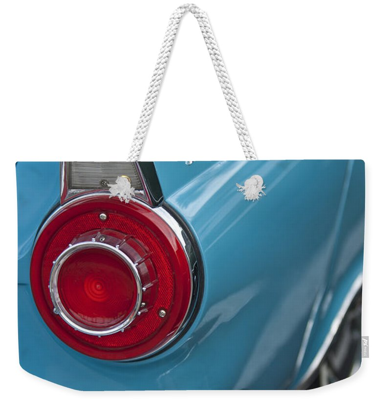 1956 Ford Thunderbird Weekender Tote Bag featuring the photograph 1956 Ford Thunderbird Taillight And Emblem by Jill Reger