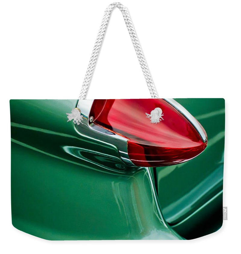 1956 Oldsmobile 98 Tail Light Weekender Tote Bag featuring the photograph 1956 Oldsmobile 98 Taillight by Jill Reger