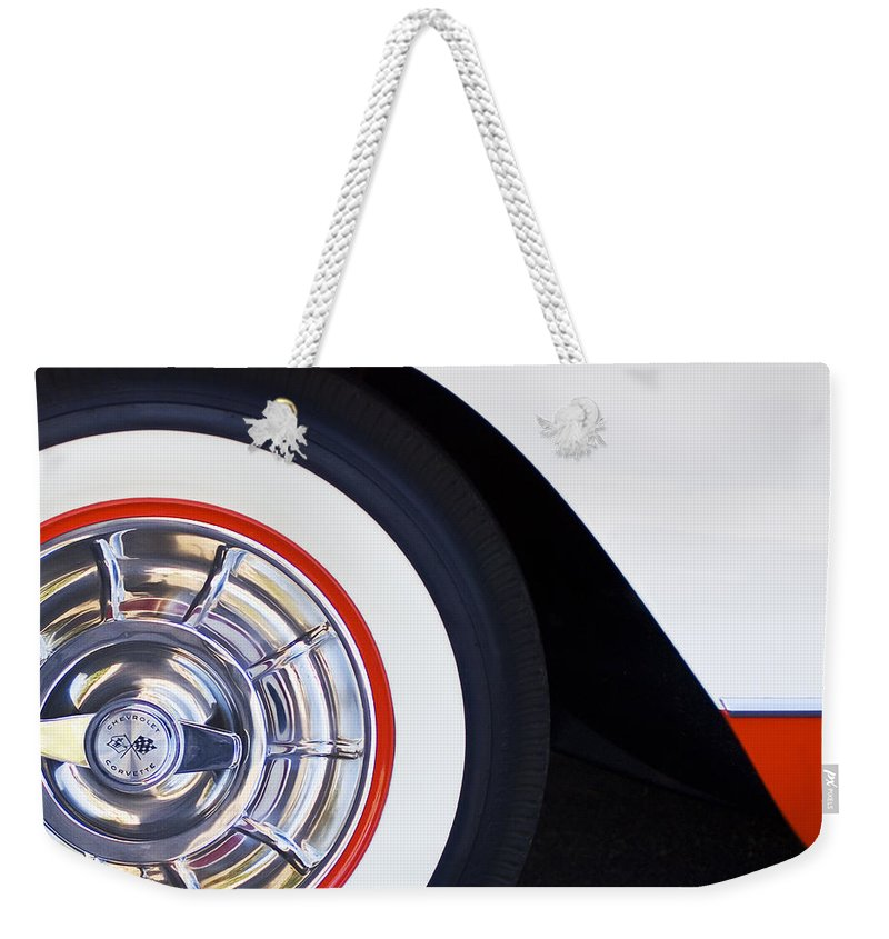 1957 Chevrolet Corvette Convertible Wheel Weekender Tote Bag featuring the photograph 1957 Chevrolet Corvette Wheel by Jill Reger