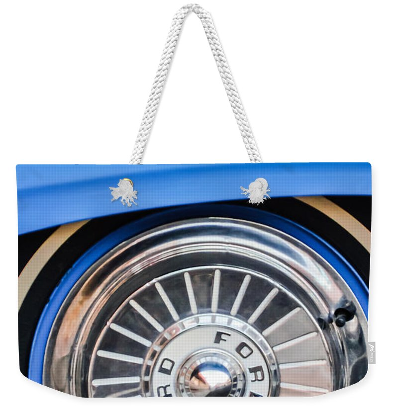 1957 Ford Fairlane Weekender Tote Bag featuring the photograph 1957 Ford Fairlane Wheel by Jill Reger