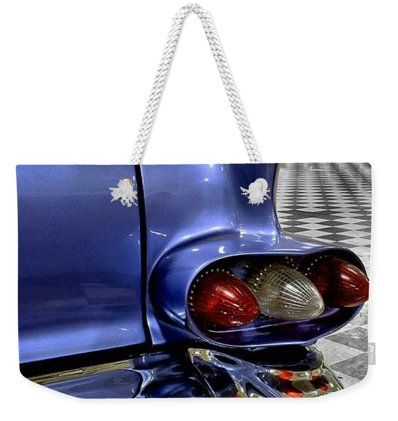 1958 Weekender Tote Bag featuring the photograph 1958 Cadillac Deville Taillight by Michael Gordon