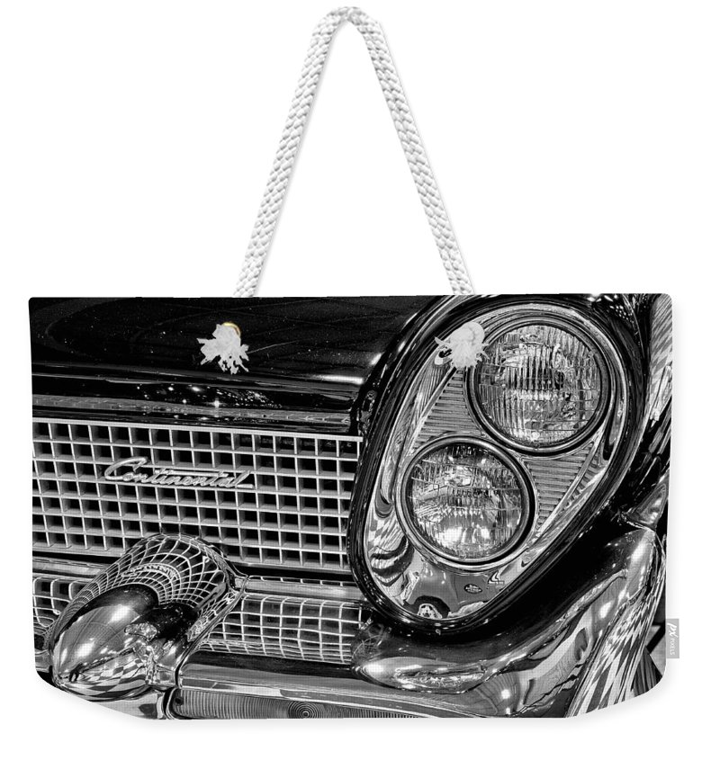 1958 Weekender Tote Bag featuring the photograph 1958 Lincoln Continental Headlight by Michael Gordon