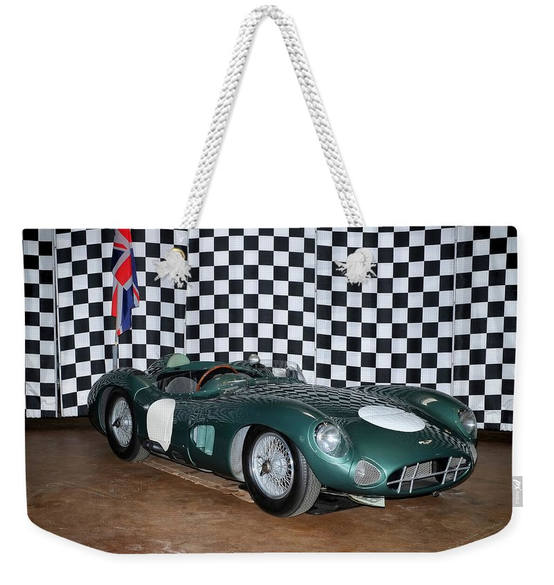 1959 Aston Martin Dbr1 Weekender Tote Bag featuring the photograph 1959 Aston Martin Dbr1 by Boris Mordukhayev