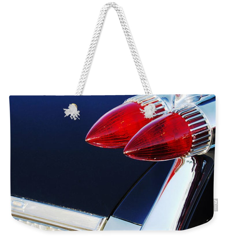1959 Cadillac Eldorado Taillight Weekender Tote Bag featuring the photograph 1959 Cadillac Eldorado Taillight -075c by Jill Reger