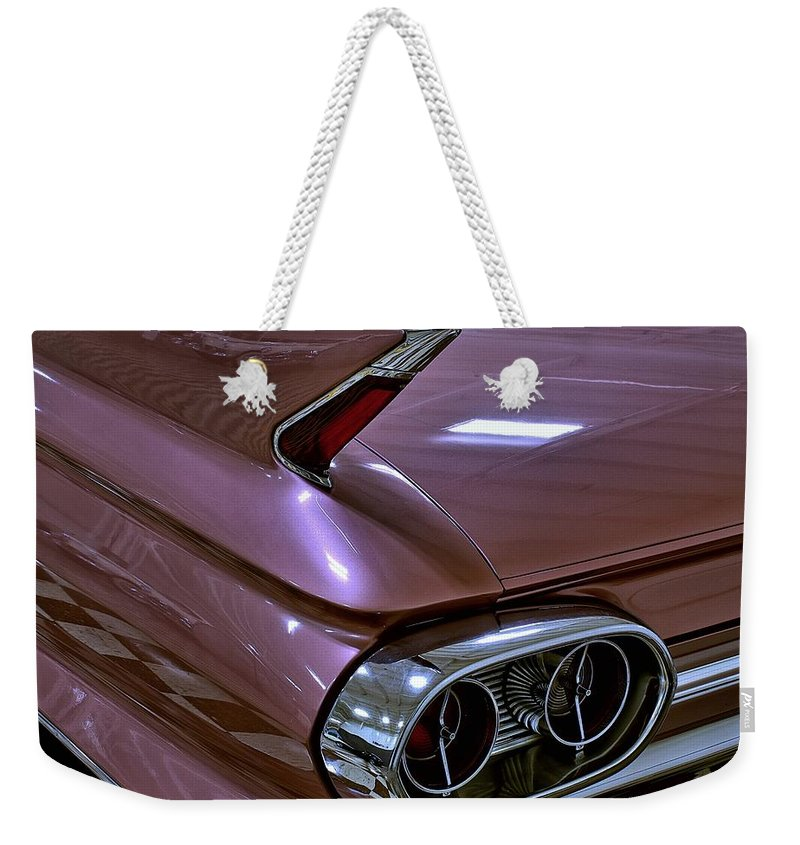 1961 Weekender Tote Bag featuring the photograph 1961 Cadillac Coupe 62 Taillight by Michael Gordon