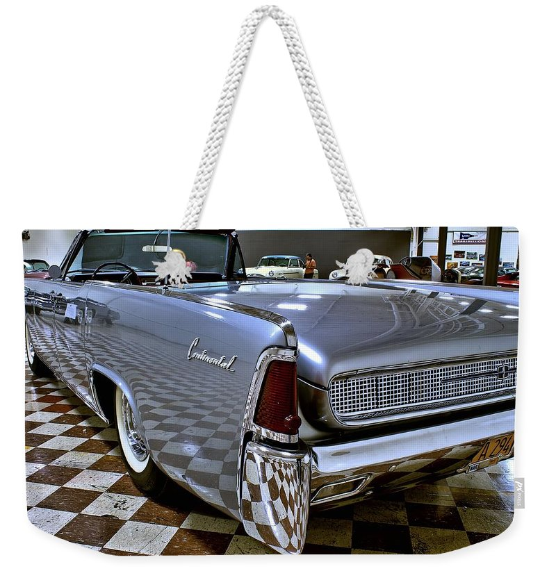 1961 Weekender Tote Bag featuring the photograph 1961 Lincoln Continental Taillight by Michael Gordon