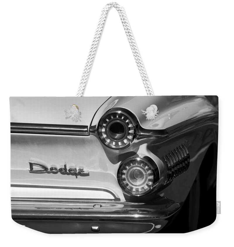 1962 Dodge Dart Taillight Emblem Weekender Tote Bag featuring the photograph 1962 Dodge Dart Taillight Emblem by Jill Reger