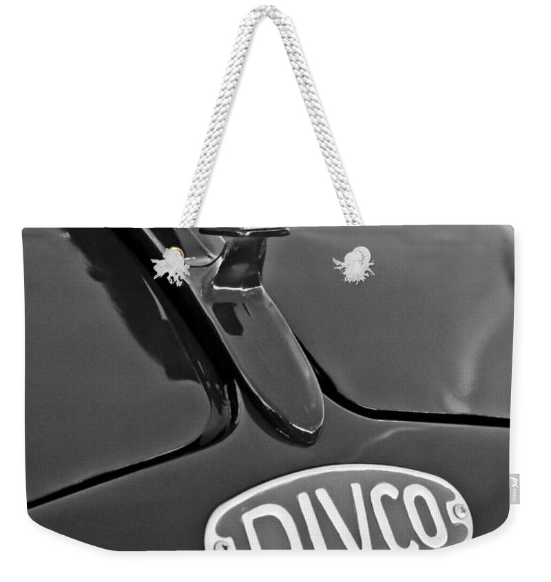 1965 Divco Weekender Tote Bag featuring the photograph 1965 Divco Milk Truck Hood Ornament 3 by Jill Reger