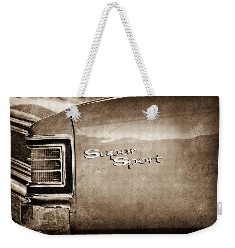 1967 Chevrolet Chevelle Ss Super Sport Taillight Emblem Weekender Tote Bag featuring the photograph 1967 Chevrolet Chevelle Ss Super Sport Taillight Emblem by Jill Reger