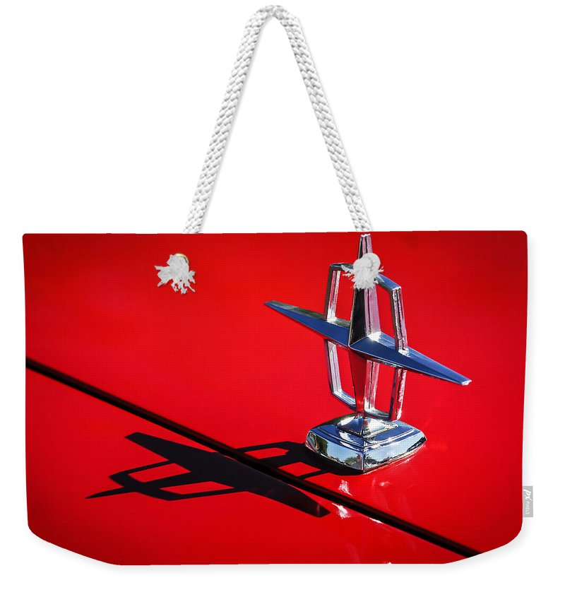1967 Lincoln Continental Hood Ornament Weekender Tote Bag featuring the photograph 1967 Lincoln Continental Hood Ornament -1204c by Jill Reger