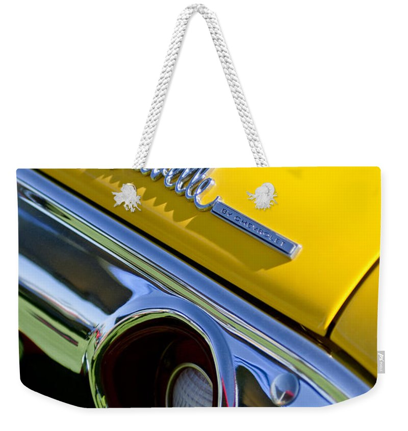 1972 Chevrolet Chevelle Weekender Tote Bag featuring the photograph 1972 Chevrolet Chevelle Taillight Emblem by Jill Reger