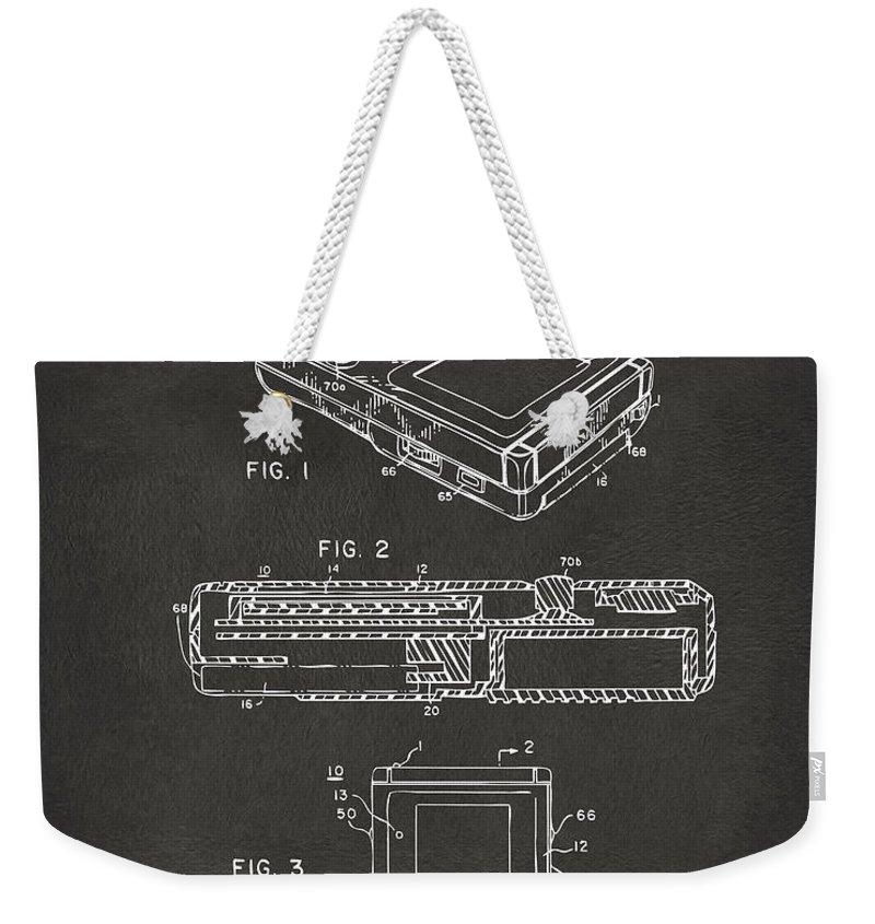 Nintendo Weekender Tote Bag featuring the digital art 1993 Nintendo Game Boy Patent Artwork - Gray by Nikki Marie Smith