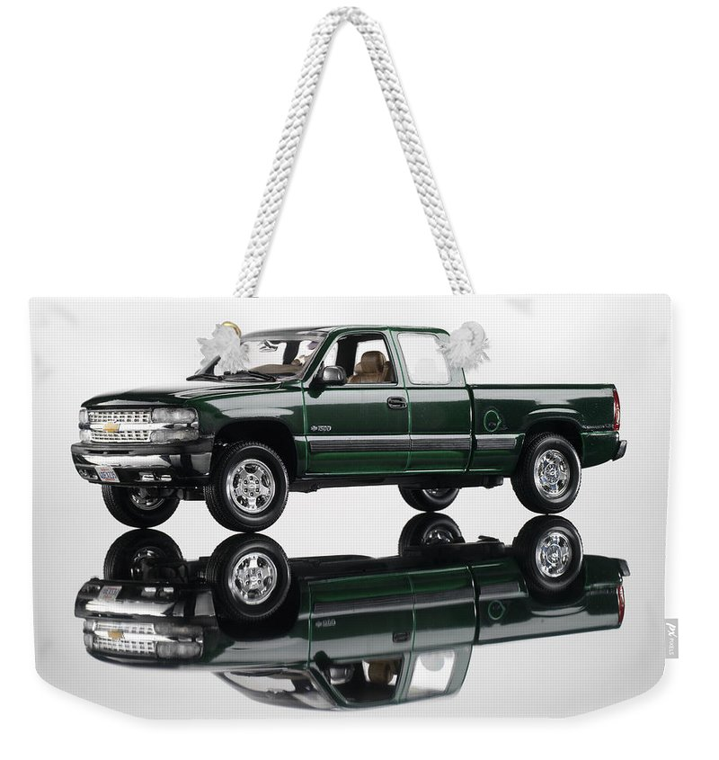 Chevrolet Weekender Tote Bag featuring the photograph 1999 Chevy Silverado Truck by Robert Mollett