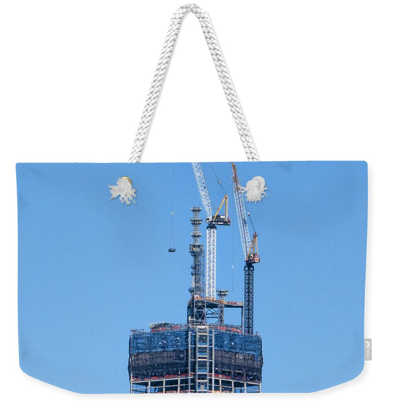 1wtc Weekender Tote Bag featuring the photograph 1wtc Antenna Erection by S Paul Sahm