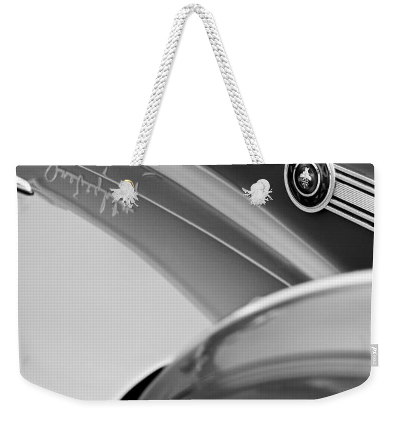 1941 Packard 1907 Custom Eight One-eighty Lebaron Sport Brougham Side Emblems Weekender Tote Bag featuring the photograph 1941 Packard 1907 Custom Eight One-eighty Lebaron Sport Brougham Side Emblems by Jill Reger