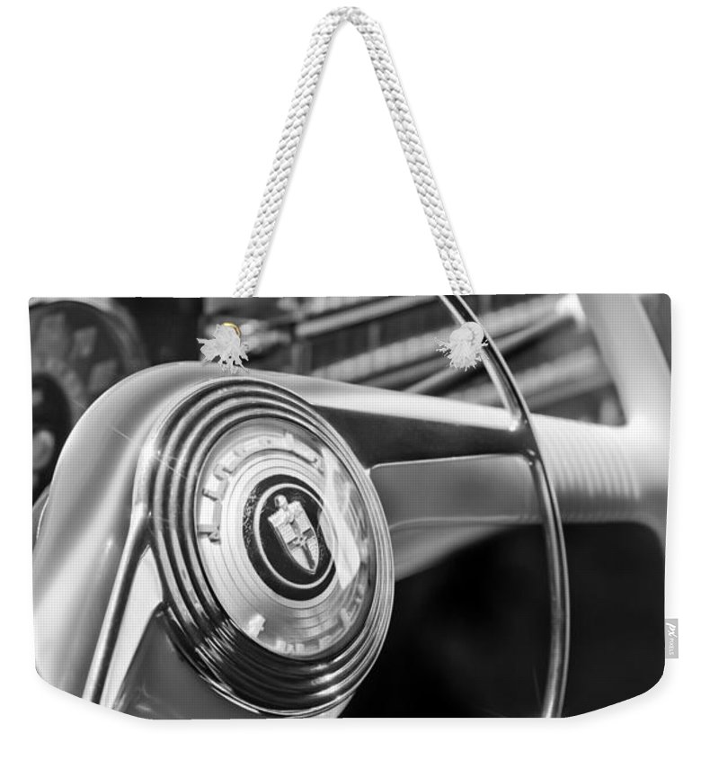 1942 Lincoln Continental Cabriolet Steering Wheel Emblem Weekender Tote Bag featuring the photograph 1942 Lincoln Continental Cabriolet Steering Wheel Emblem by Jill Reger