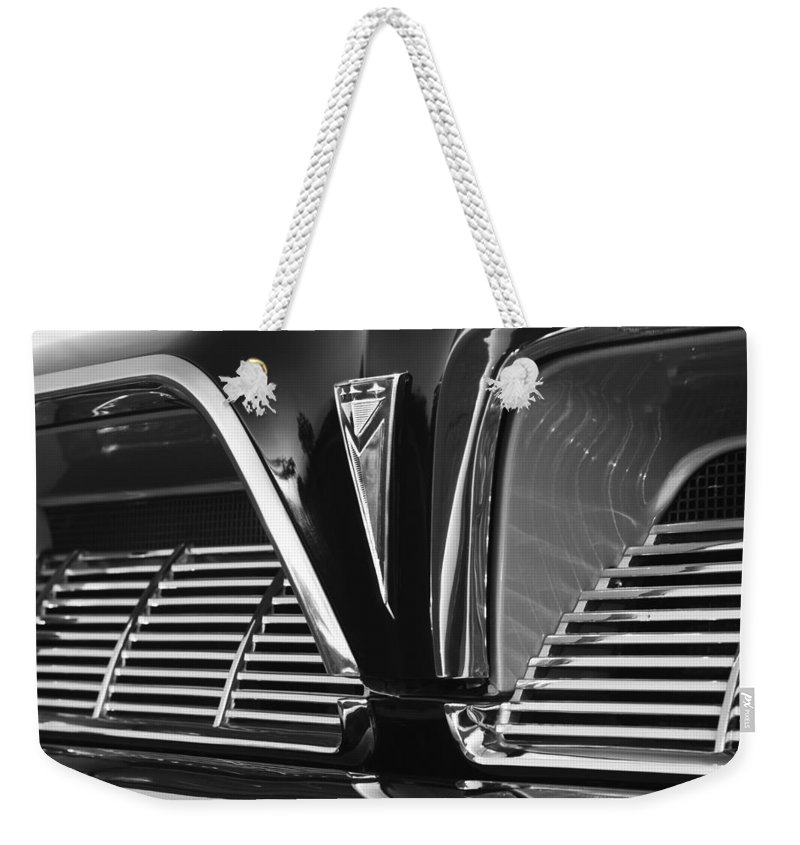 1961 Pontiac Catalina Grille Emblem Weekender Tote Bag featuring the photograph 1961 Pontiac Catalina Grille Emblem by Jill Reger
