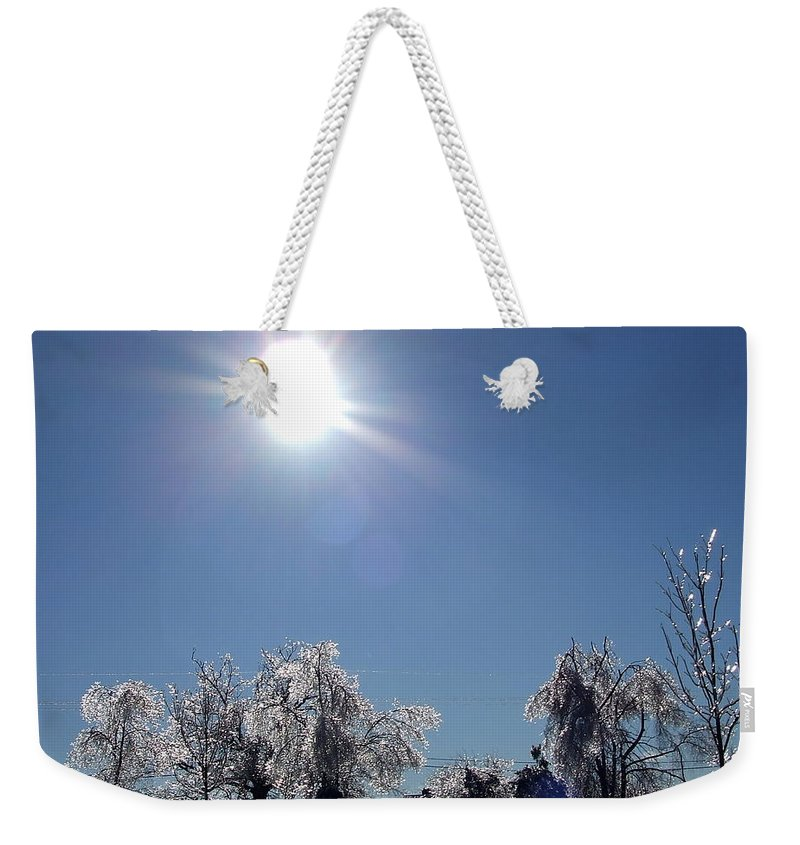 Ragged Weekender Tote Bag featuring the photograph After The Ice Storm by Susan Wyman
