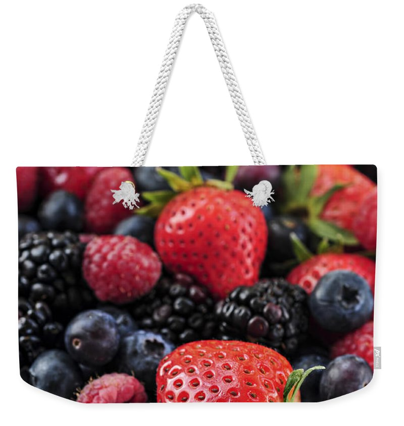 Berry Weekender Tote Bag featuring the photograph Assorted Fresh Berries by Elena Elisseeva