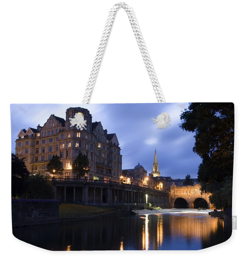 Bath Weekender Tote Bag featuring the photograph Bath City Spa Viewed Over The River Avon At Night by Mal Bray