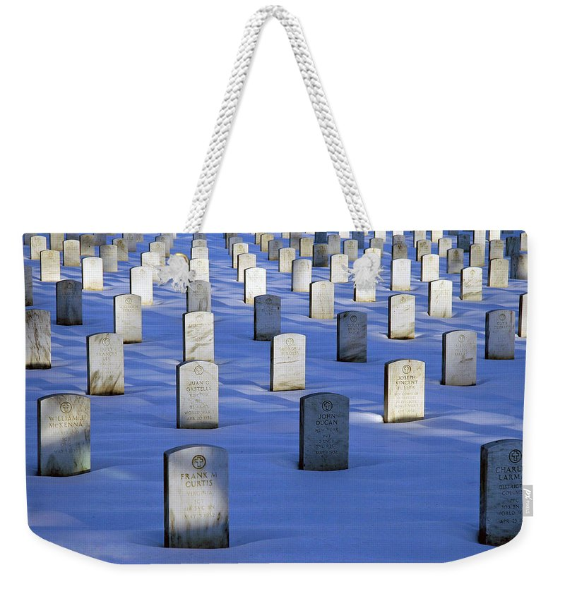 Arlington National Cemetery Weekender Tote Bag featuring the photograph Beneath The Snow by Cora Wandel