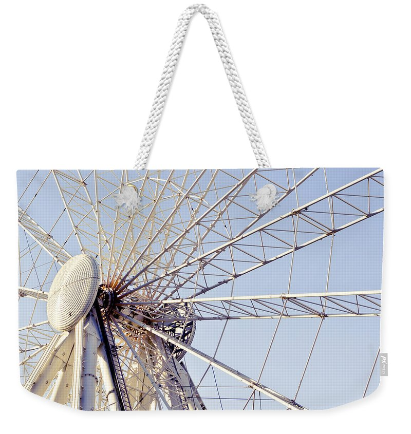 Action Weekender Tote Bag featuring the photograph Big Wheel by Tom Gowanlock