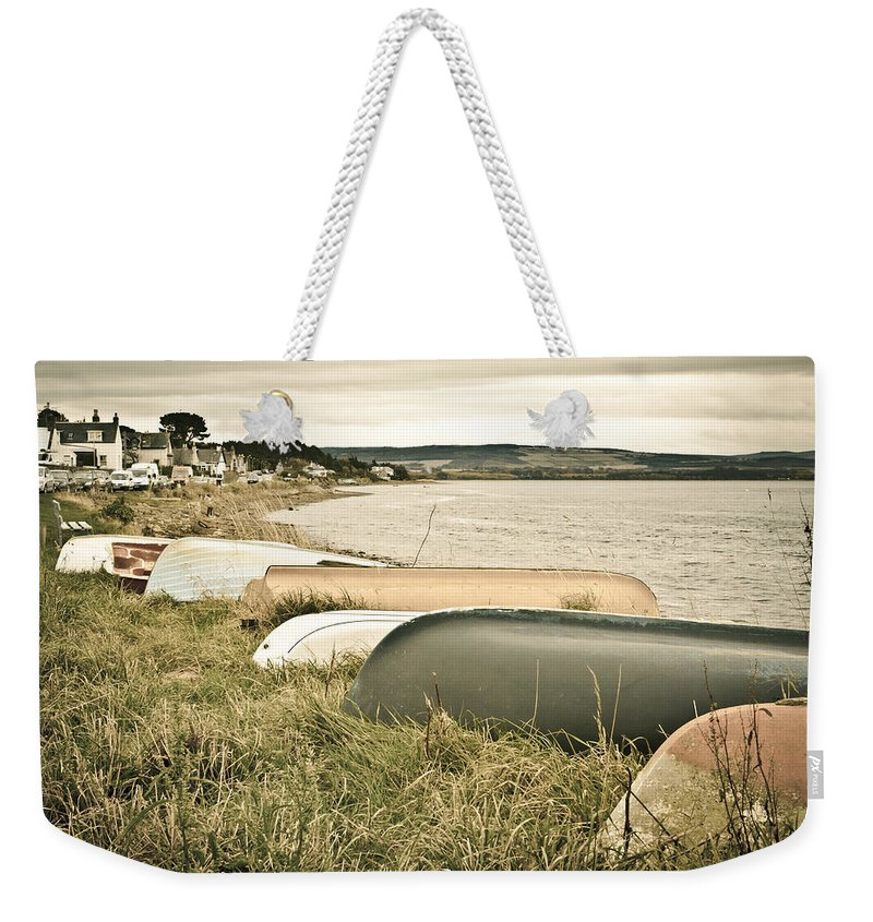 .moray Weekender Tote Bag featuring the photograph Boats At Findhorn by Tom Gowanlock