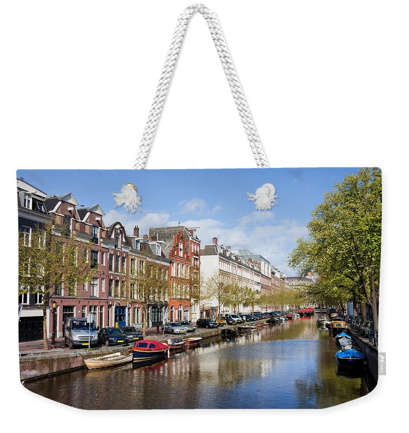 Amsterdam Weekender Tote Bag featuring the photograph Boats On Amsterdam Canal by Artur Bogacki