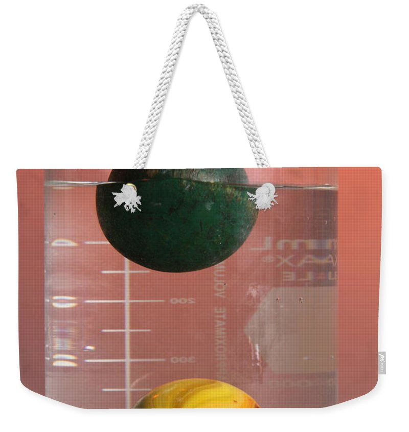 Beaker Weekender Tote Bag featuring the photograph Buoyancy Test by Photo Researchers, Inc.