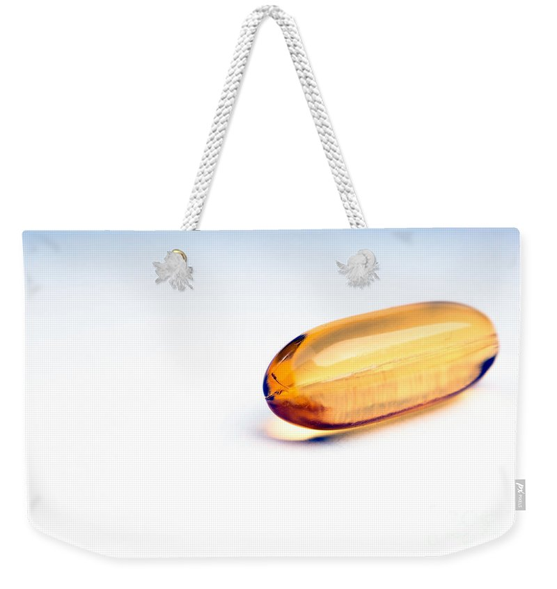 Capsule Weekender Tote Bag featuring the photograph Capsules by Tim Hester