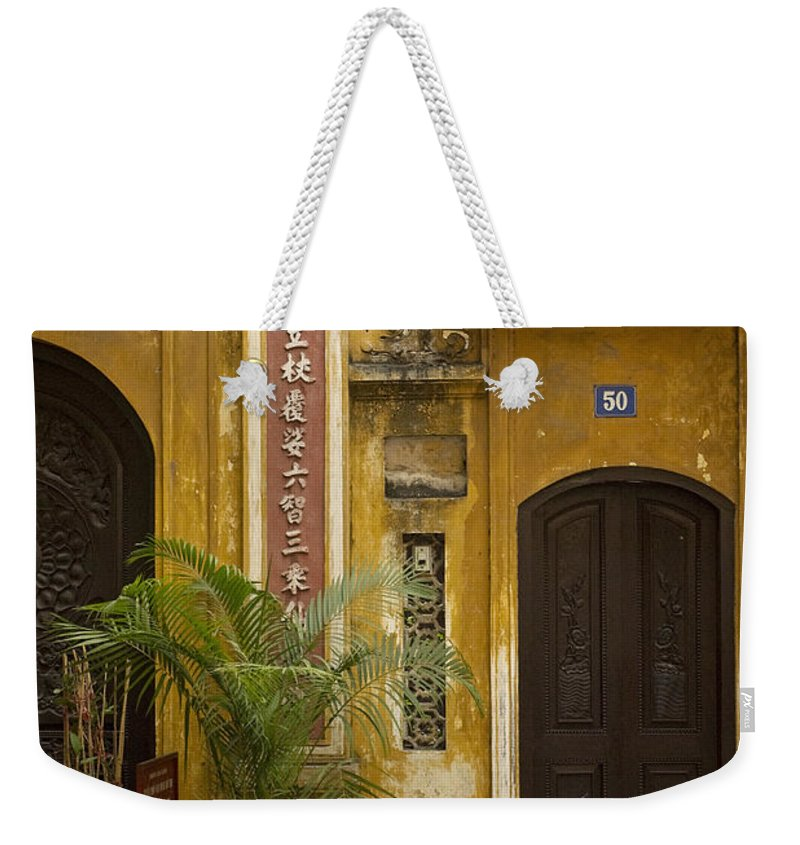 Chinese Weekender Tote Bag featuring the photograph Chinese Temple In Hanoi Vietnam by Jacek Malipan