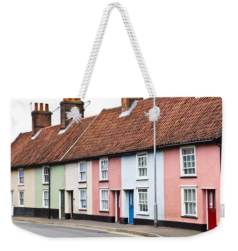Blue Weekender Tote Bag featuring the photograph Colorful Houses by Tom Gowanlock