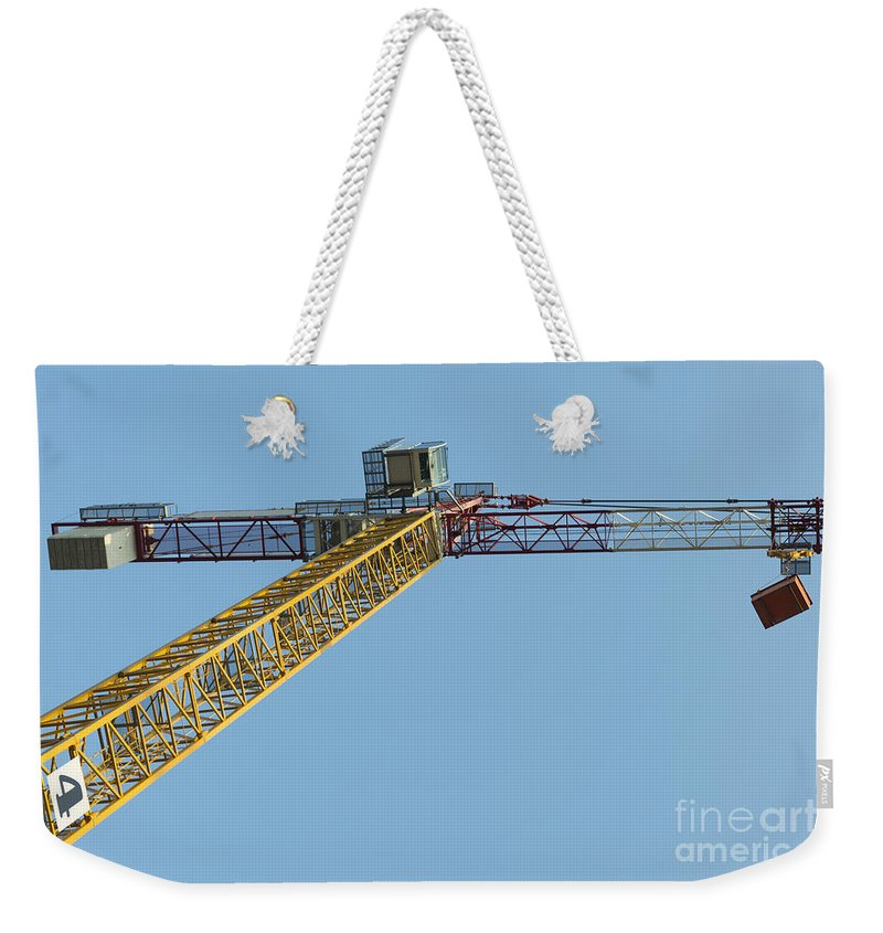 Construction Crane Weekender Tote Bag featuring the photograph Crane by Mats Silvan