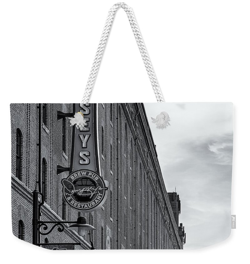 Baltimore Weekender Tote Bag featuring the photograph Dempseys Brew Pub by Susan Candelario