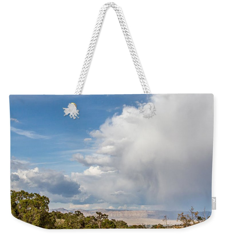 Colorado Weekender Tote Bag featuring the photograph Desert Clouds by Jeff Stoddart