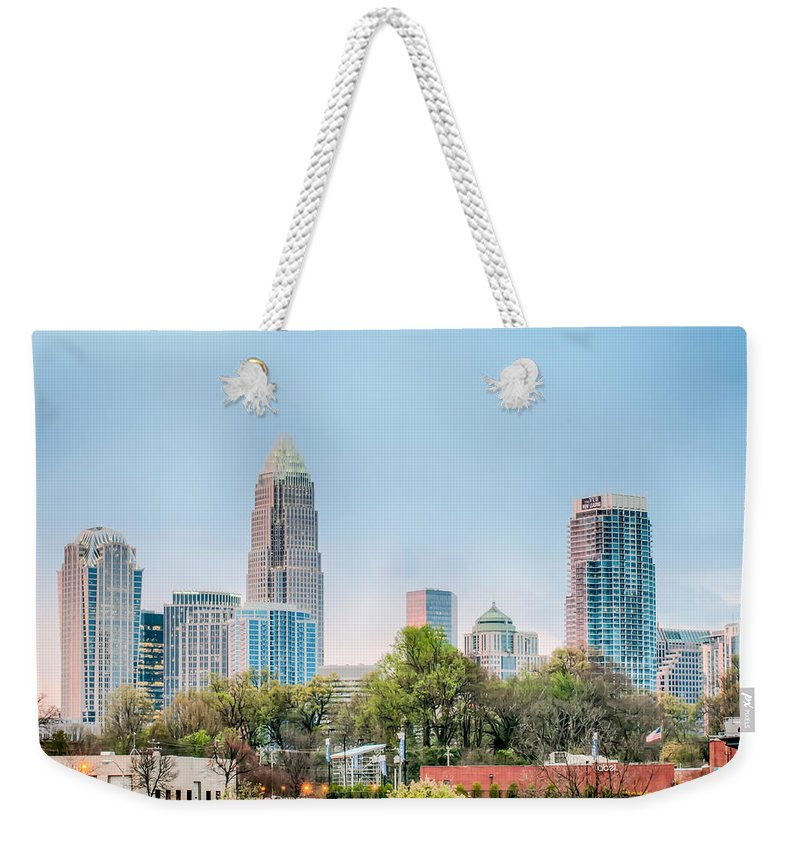 Early Weekender Tote Bag featuring the photograph Early Morning Sunrise Over Charlotte City Skyline Downtown by Alex Grichenko