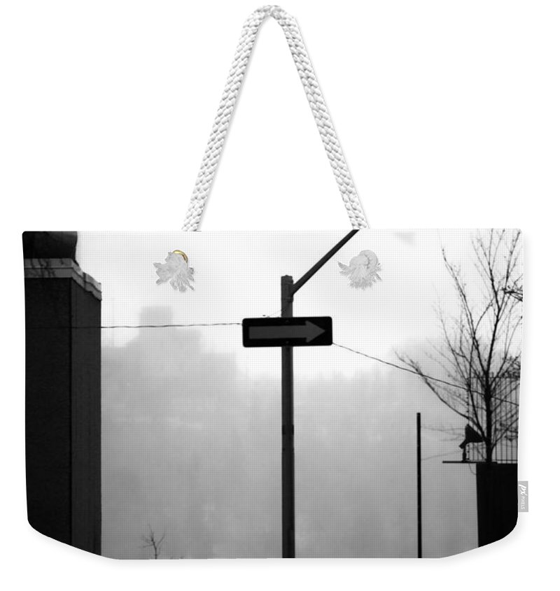 Street Photography Weekender Tote Bag featuring the photograph East Wind by The Artist Project