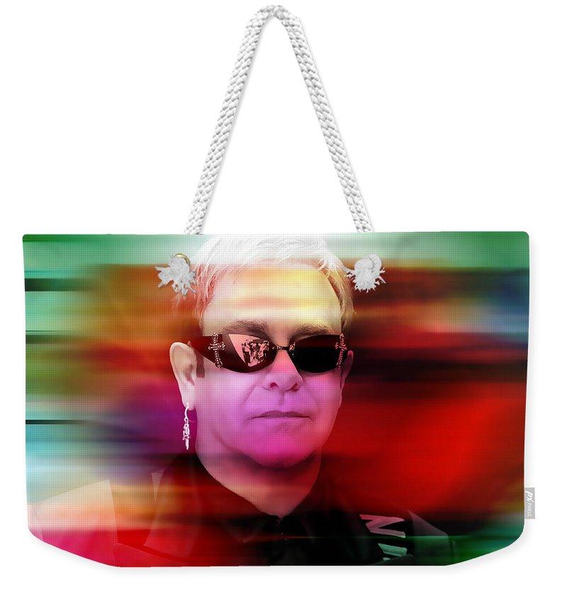 Elton John Photographs Weekender Tote Bag featuring the mixed media Elton John by Marvin Blaine