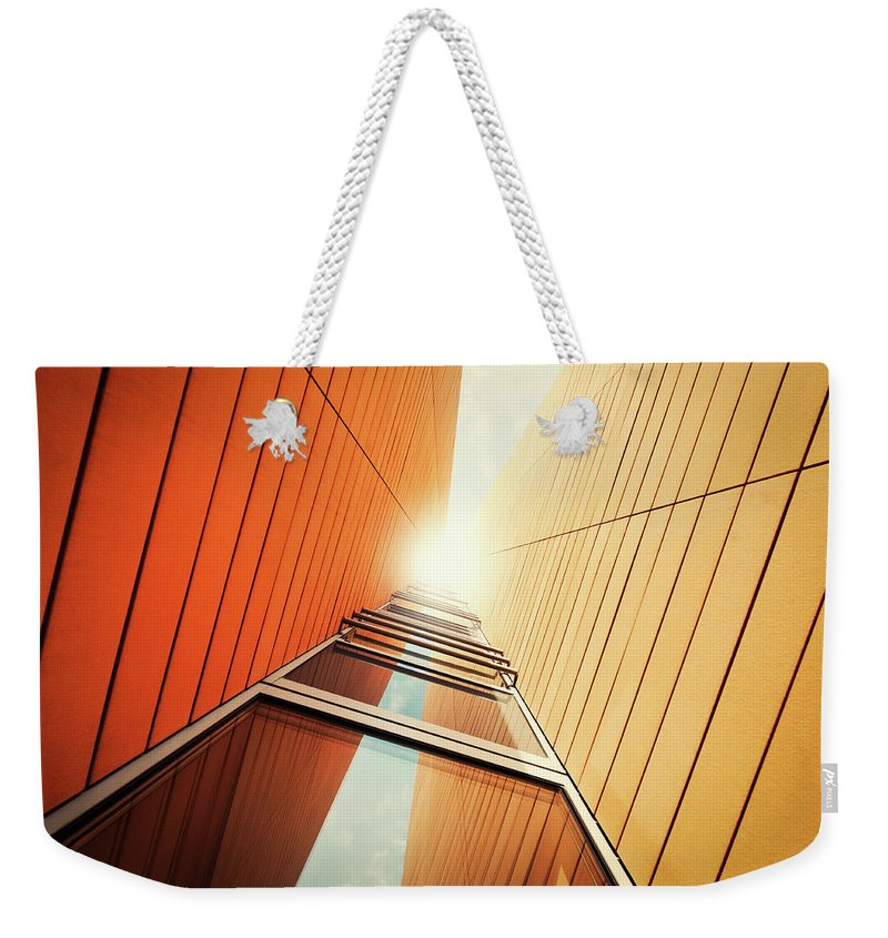 Corporate Business Weekender Tote Bag featuring the photograph Futuristic Office Building by Ppampicture