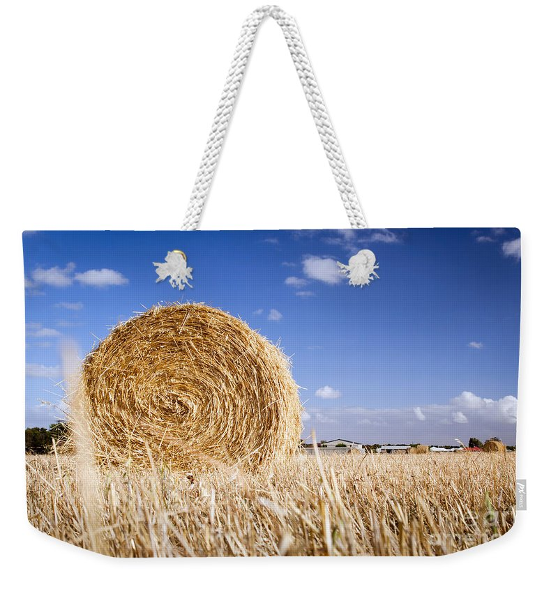 Farm Weekender Tote Bag featuring the photograph Hay Bales by Tim Hester