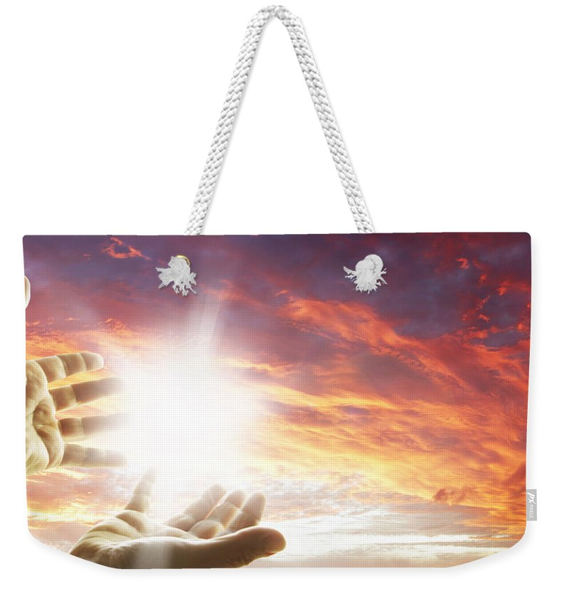 Hands Weekender Tote Bag featuring the photograph Hope by Les Cunliffe
