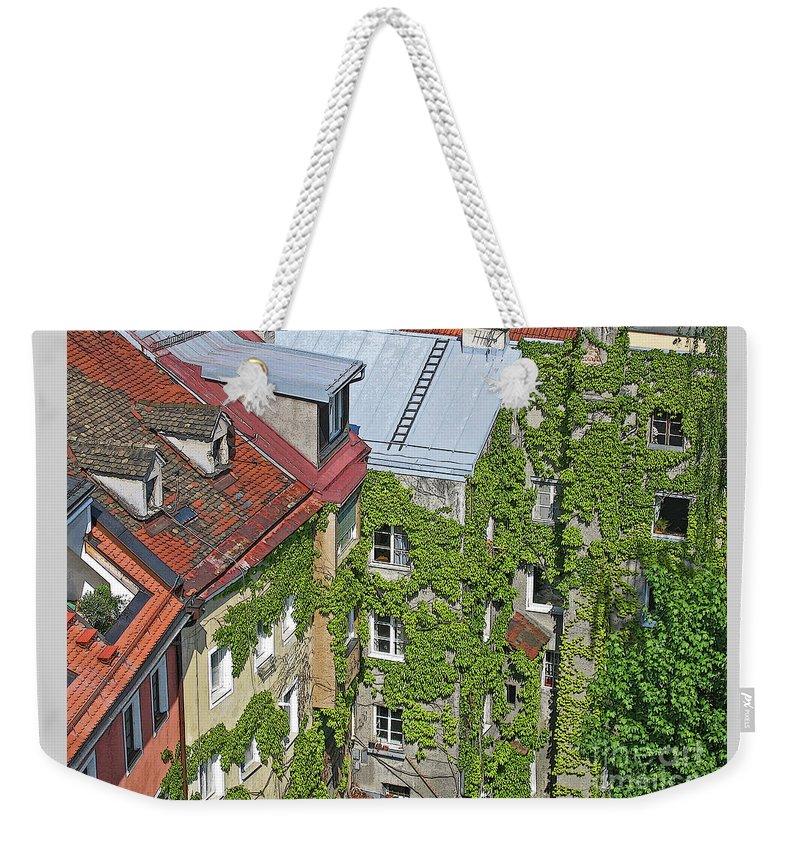 Innsbruck Weekender Tote Bag featuring the photograph Ivy Courtyard by Ann Horn