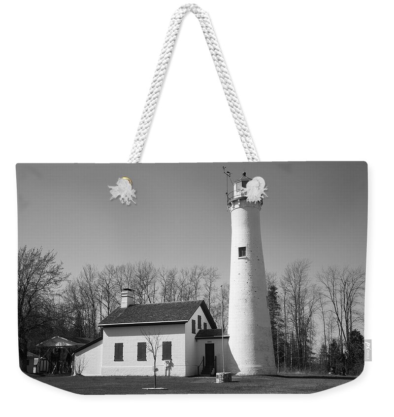 America Weekender Tote Bag featuring the photograph Lighthouse - Sturgeon Point Michigan by Frank Romeo