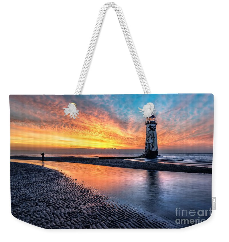 Sunset Weekender Tote Bag featuring the photograph Lighthouse Sunset by Adrian Evans