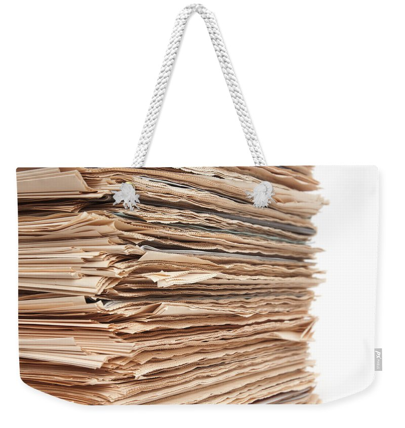 Newspaper Weekender Tote Bag featuring the photograph Newspaper Stack by Chevy Fleet