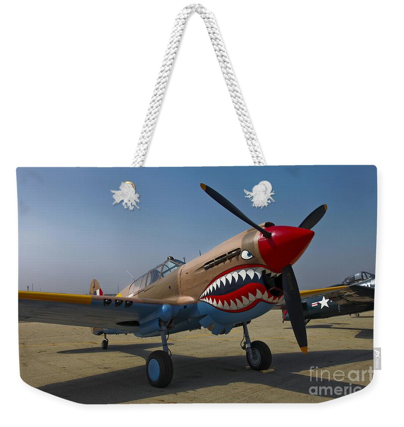 Horizontal Weekender Tote Bag featuring the photograph Nose Art On A Curtiss P-40e Warhawk by Scott Germain