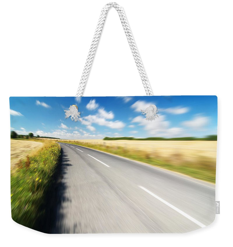 Road Weekender Tote Bag featuring the photograph On The Road by Chevy Fleet